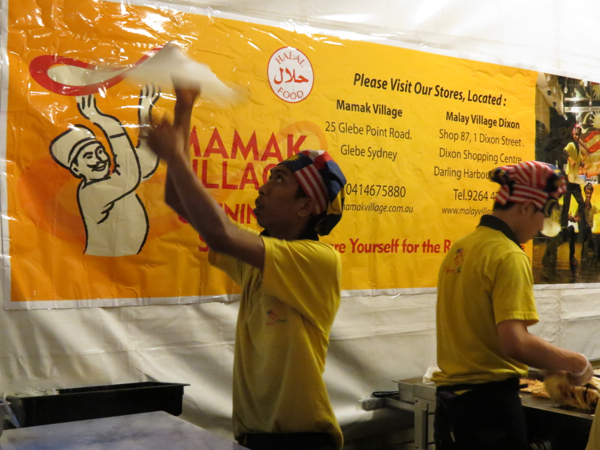 Man making roti at Mamak Village stall during Night Noodle Markets at the Crave Sydney International Food Festival.