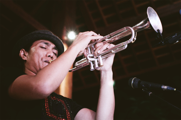 Rio Sidik (playing trumpet), one of the musicians performing at the inaugural Ubud Village Jazz Festival.