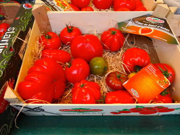 Heirloom tomatoes at fresh food market at Conflans Ste Honorine by the Seine River near Paris.