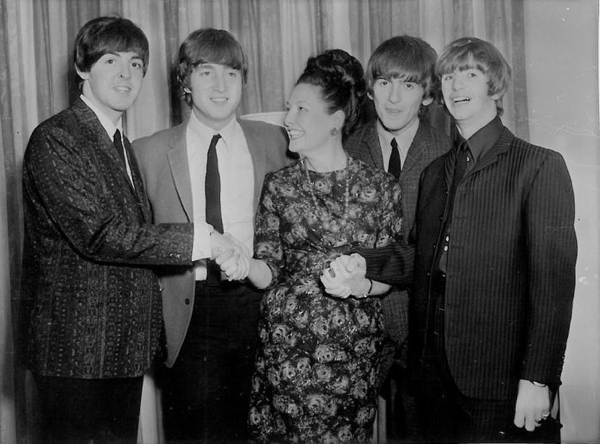 Australian broadcaster Binny Lum with The Beatles at the Southern Cross Hotel, Melbourne, June 14 1964.
