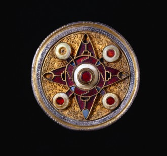 Wingham Brooch, silver-gilt, niello, garnet, glass and shell, 575–625, found in England. British Museum curated Medieval Power exhibition at the Queensland Museum.