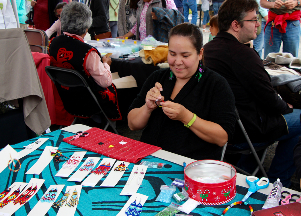 Beading during the craft fair on National Aboriginal Day.