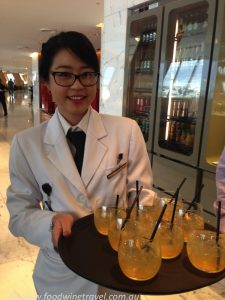 Woman with cocktails made from Qantas honey