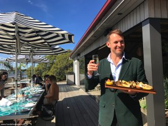 Paul West with grilled bugs at the Sandstone Point Hotel oyster shed. Here's cheers to the upcoming Regional Flavours.