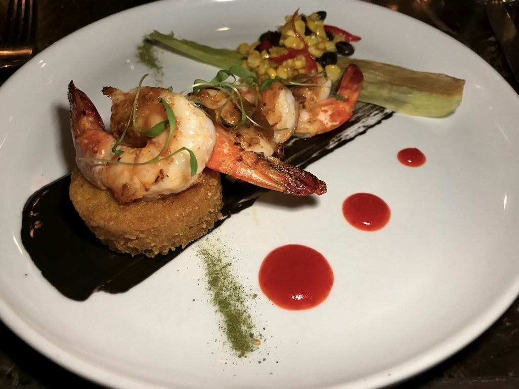 Fins Restaurant King prawns from the Tweed served with a crispy turmeric and coconut rice cake, chilli jam, and barbecued corn with lemon aspen butter