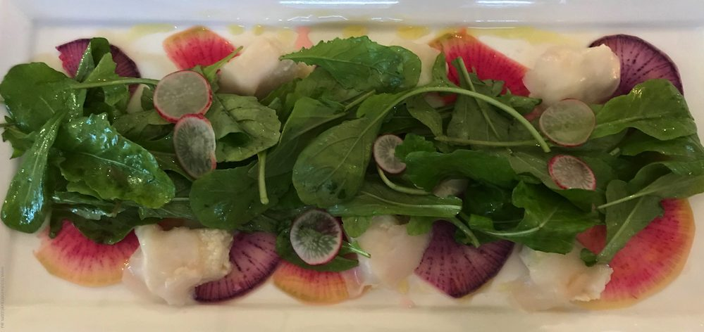 Whidbey Island Orchard Kitchen Olive Oil Poached Halibut and Geoduck Sashimi Salad of Arugula, Shaved Radish & Rhubarb Mignonette