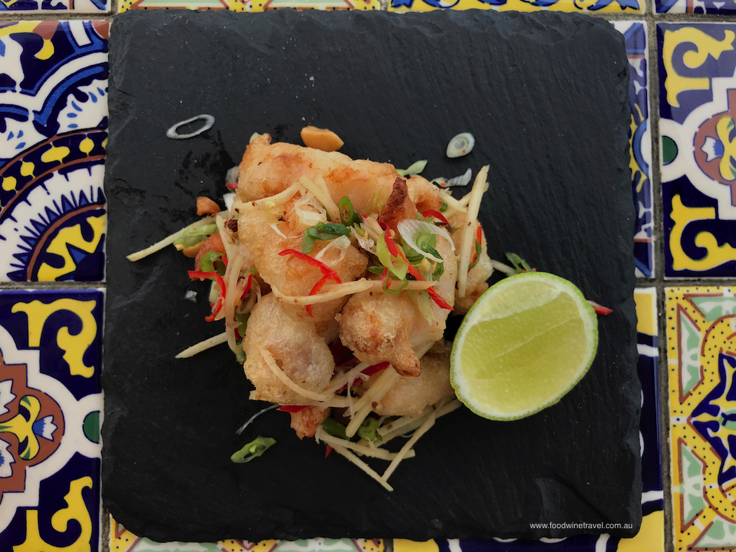 Suttons Beach Pavilion Salt and pepper king prawns with ginger spring onion chilli and macadamia nut dressing