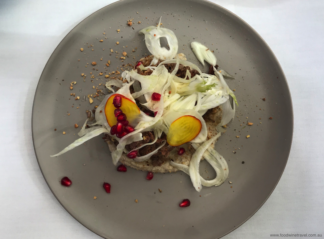 Braised lamb shoulder with baba ganoush, pistachio dukkah, shaved fennel and pomegranate.
