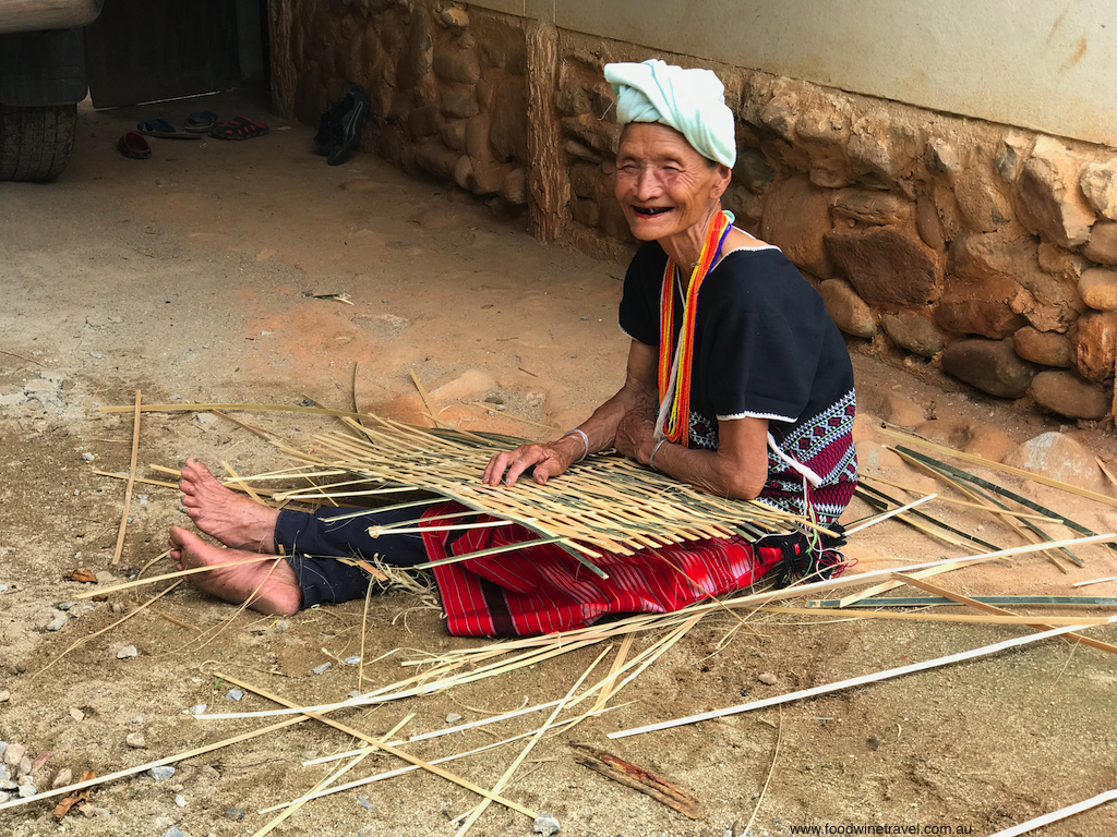 A Karen woman making a fence to keep in chickens.