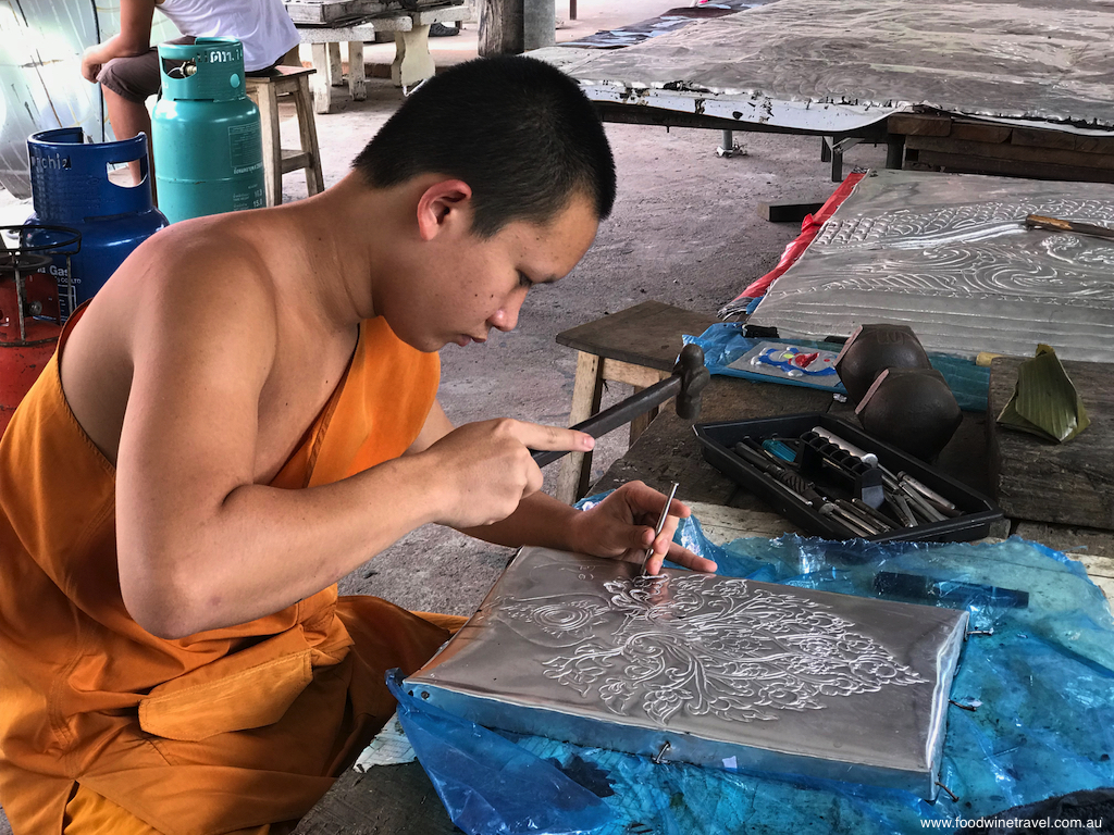 A young monk in the silver workshops near the Silver Temple.
