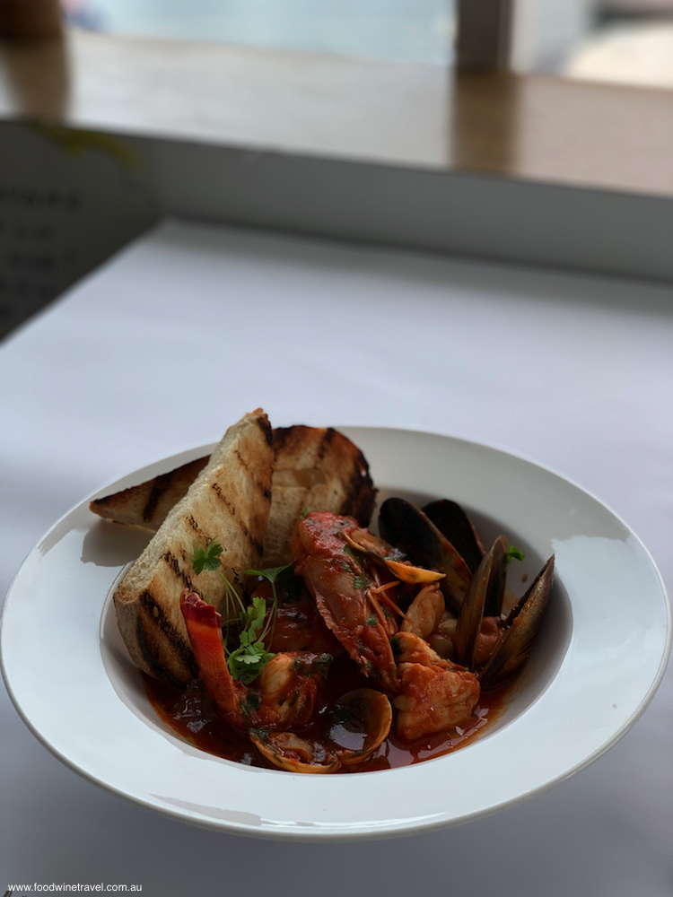 The seafood soup is replete with mussels, prawns, scallops and cockles.
