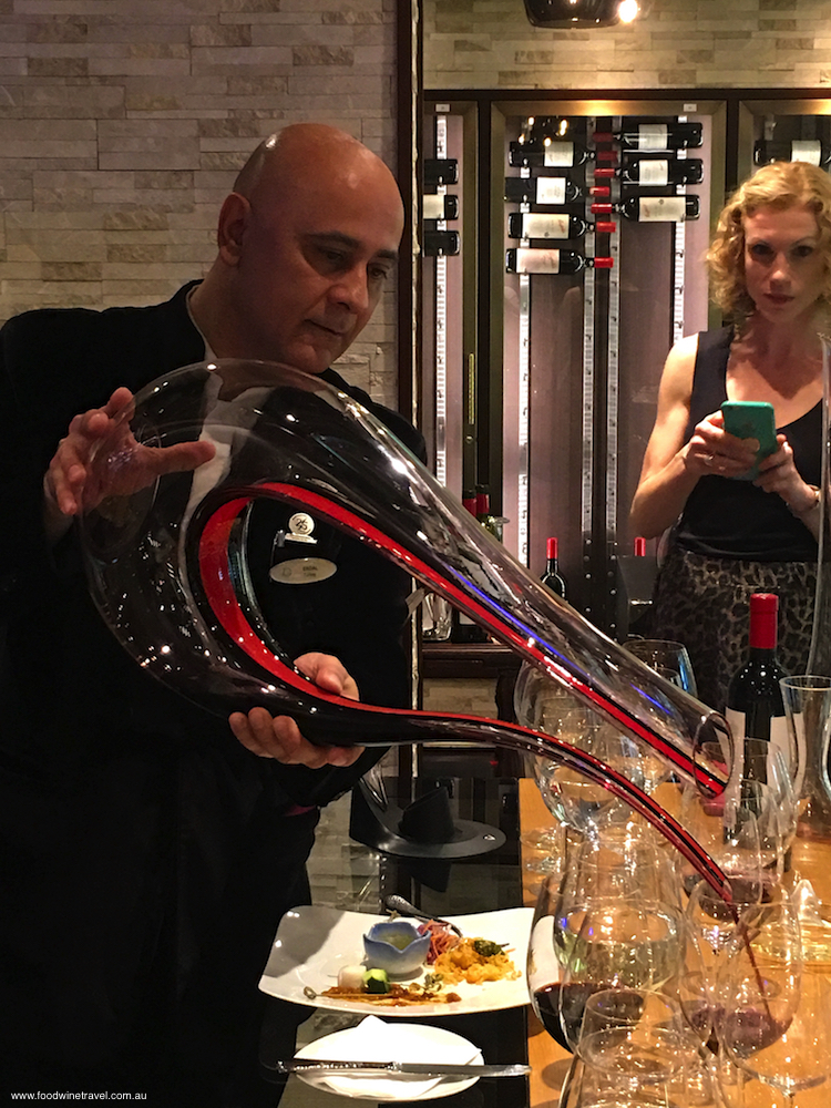 Genting Dream's Cellar Master Erdal Uysal pours from a mighty decanter.