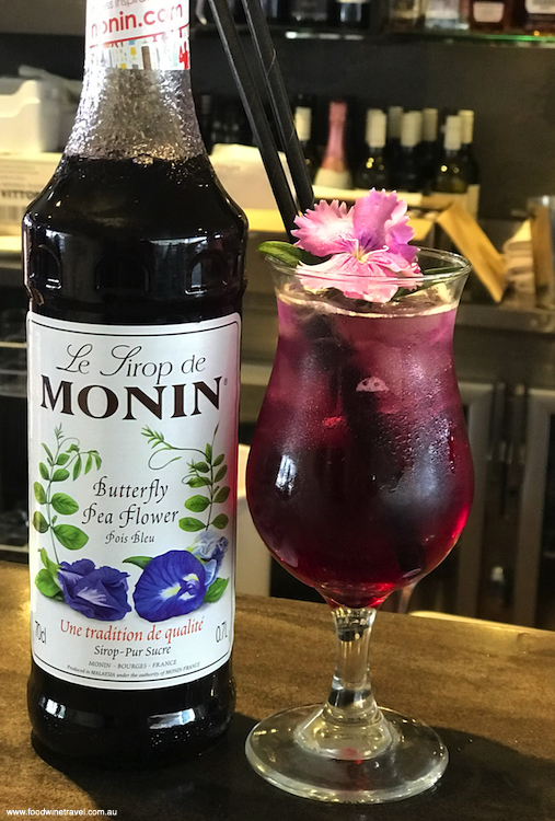 Monin's dessert cocktail of vodka, butterfly pea, soda and ice.