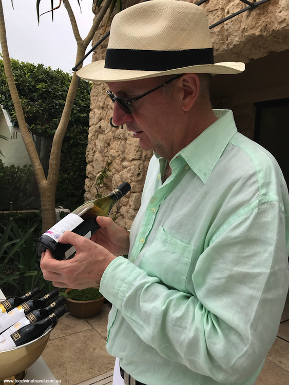Winemaker and managing director of Taylors Wines, Mitchell Taylor, points out  sensors indicating the wine's temperature.