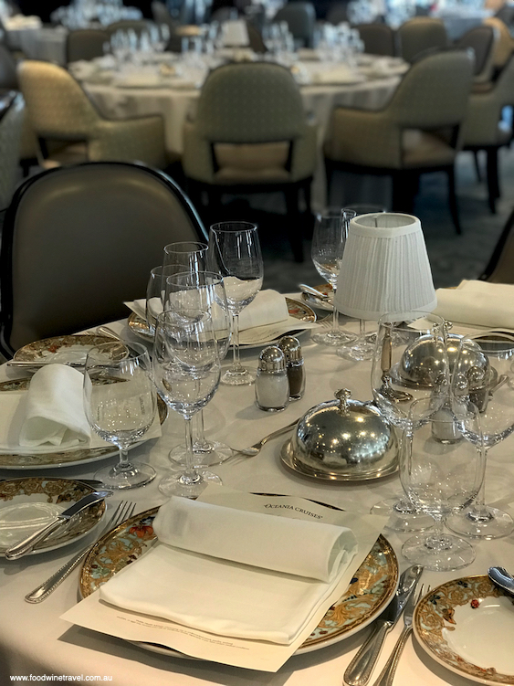The Grand Dining Room is very elegant with tables set with Riedel crystal and Versace china.