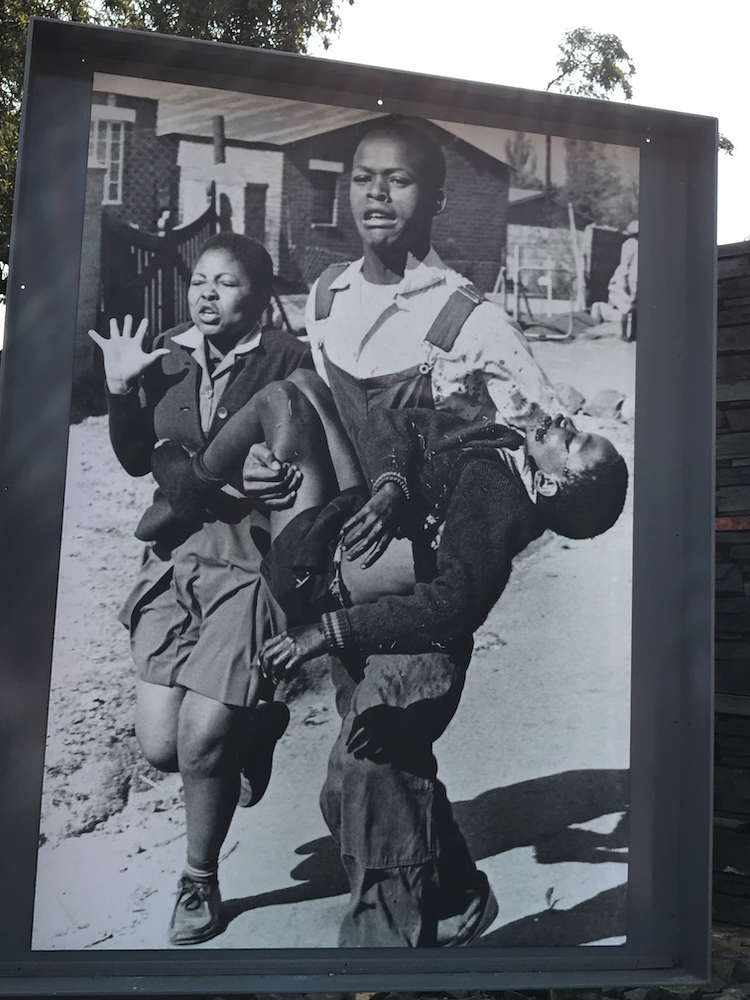 Antoinette and her dying brother, Hector Pieterson, in Sam Nzima's iconic photo.