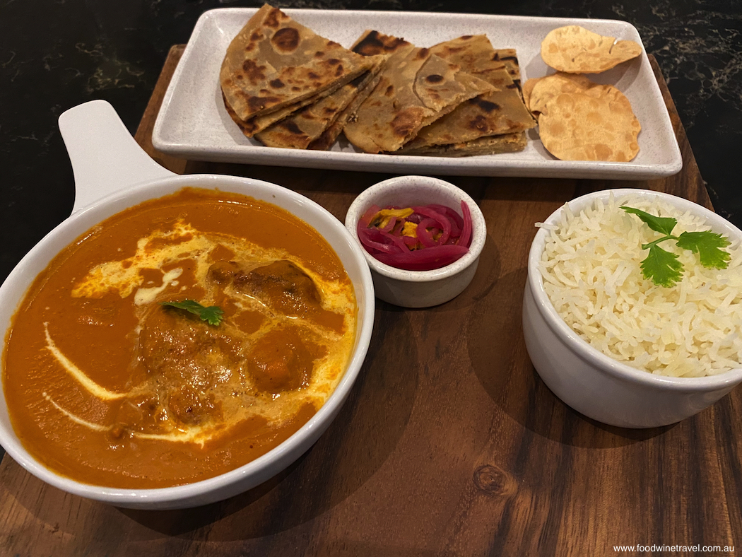 Hotel Grand Windsor Auckland Butter chicken with steamed rice paratha homemade pickle and poppadum