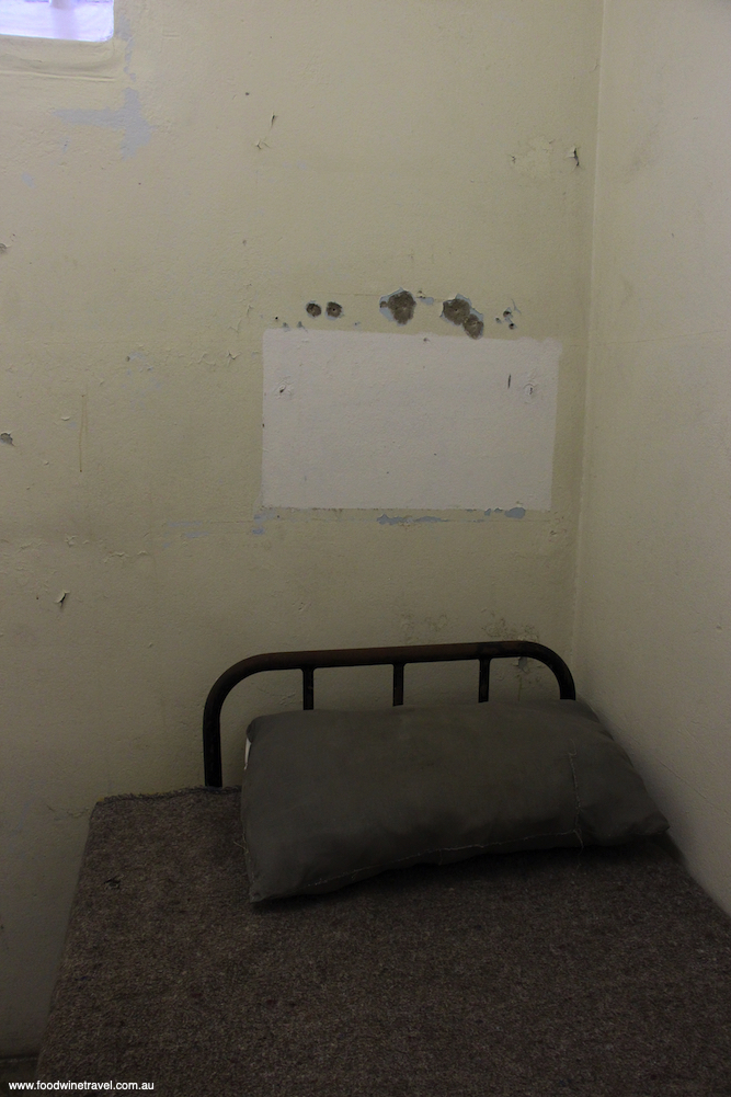 Inside Mandelas cell Robben Island Cape Town sites associated with Nelson Mandela