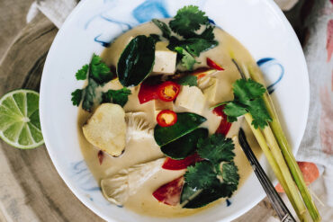 Recipe for a vegan Thai soup, Tom Kha Gai With Mushrooms, from Global Vegan by Ellie Bullen.