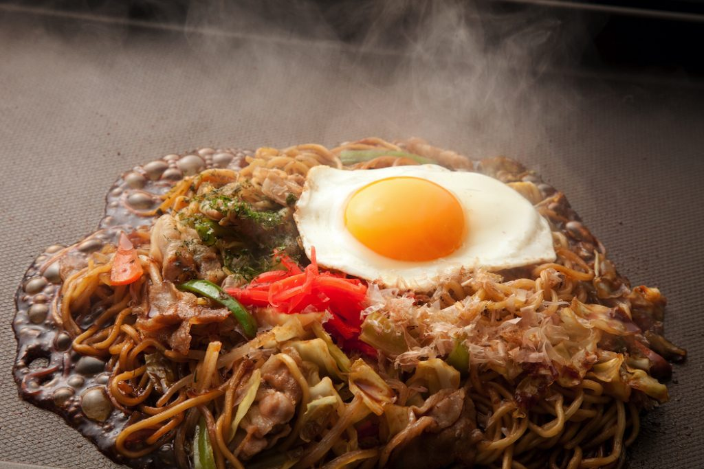 Noodles cooked on a teppanyaki hotplate are a speciality at family-run Fuku-chan restaurant.