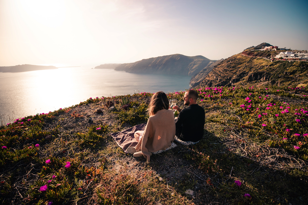 Catch the sunset with a private picnic organized by Santorini Secret Suites & Spa.