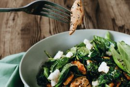 Recipe for Stir-fried chicken and basil salad on just-wilted spinach, from Eat Your Way Slim & Healthy.