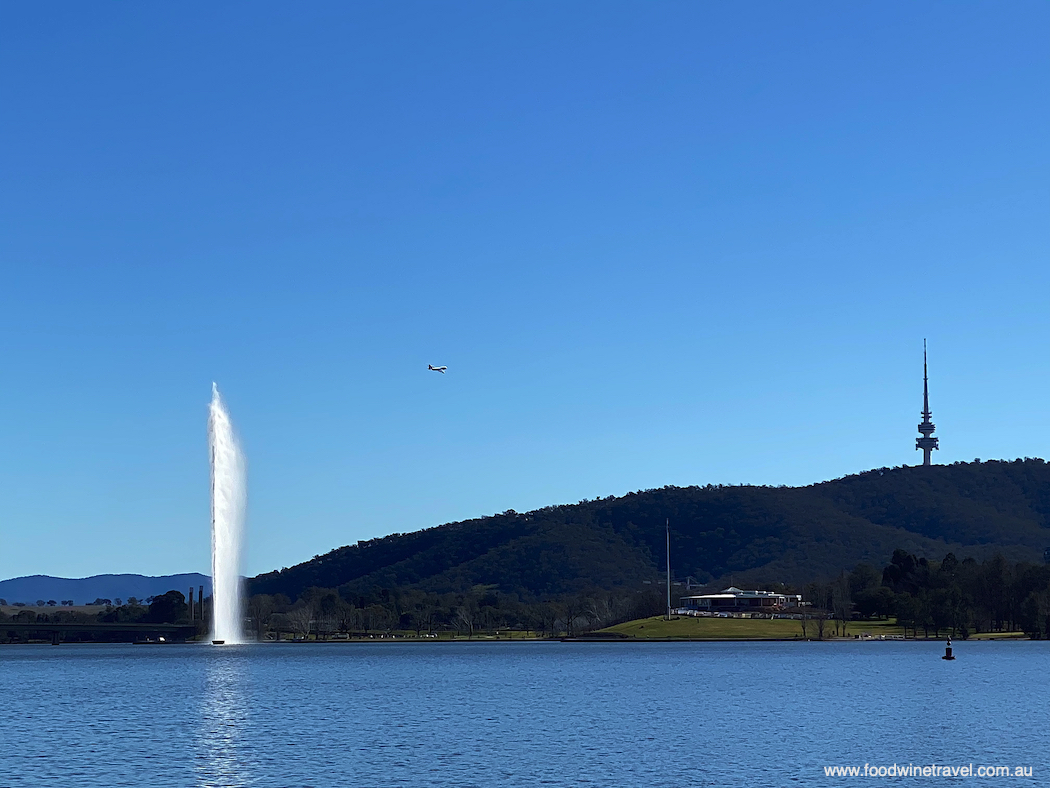 Qantas retires its Boeing 747 with a flyover Canberra's Lake Burley Griffin.