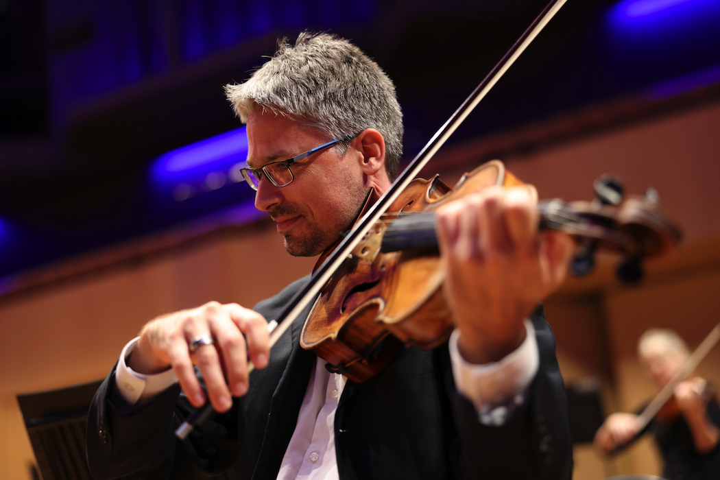 Principal viola, Imants Larsens, in a solo performance of Romance in F Op. 85.