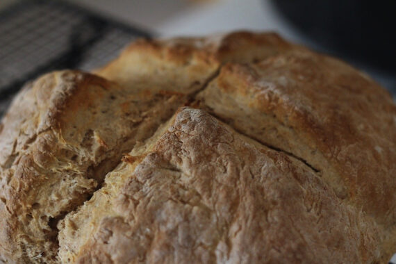 Irish folklore dictates that a deep cross must be cut into the top of soda bread. Do you know why?